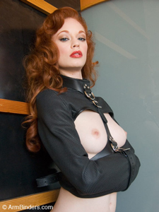 Justine Joli in a Perforated Leather StraitJacket